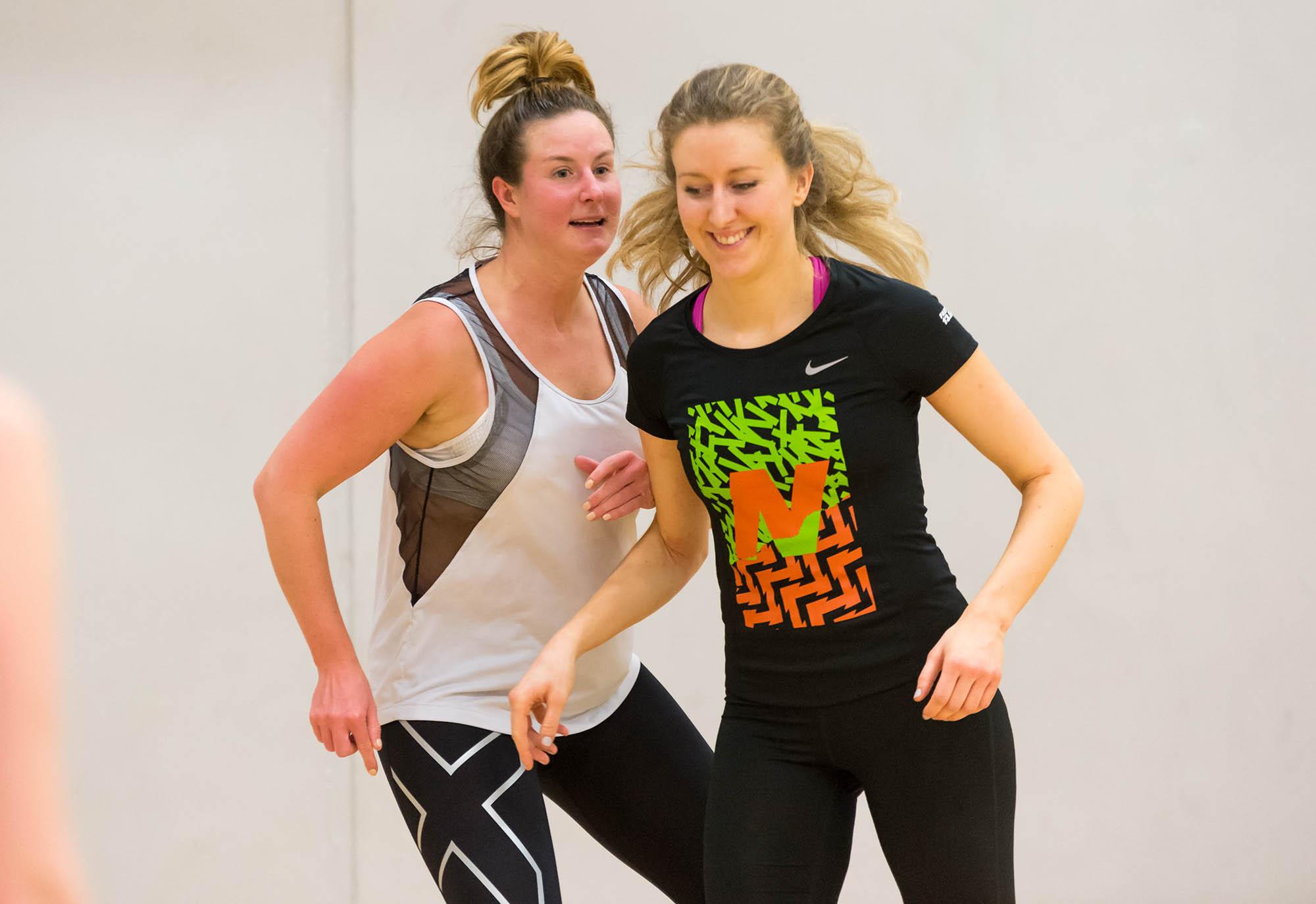 Two women playing netball (c) sport england 1