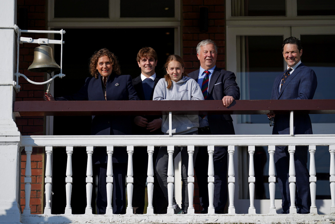 Captain sir tom's family with guy lavender (chief executive mcc) ring the bell at lord's to mark the start of the captain tom 100 weekend